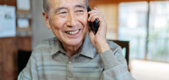 Senior man talking on a cell phone smiling