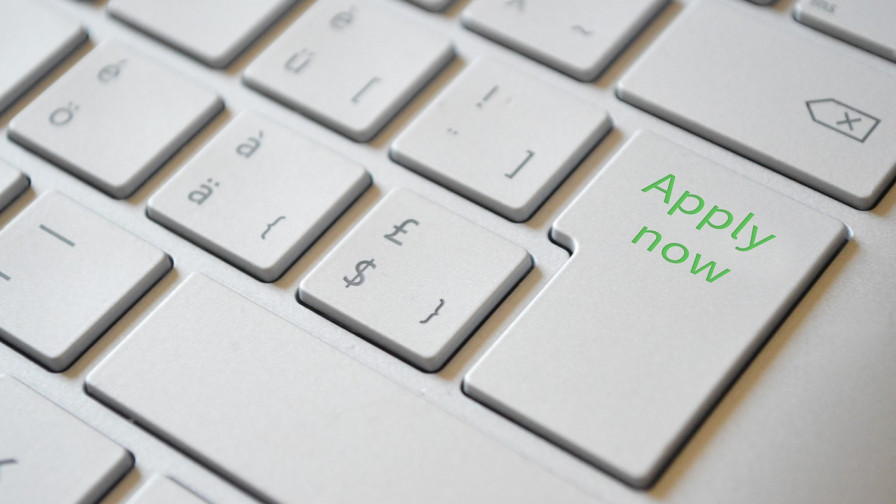 Apply now text on a keyboard