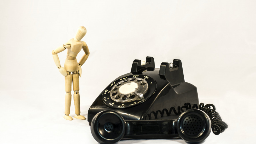 Black telephone near a mannequin