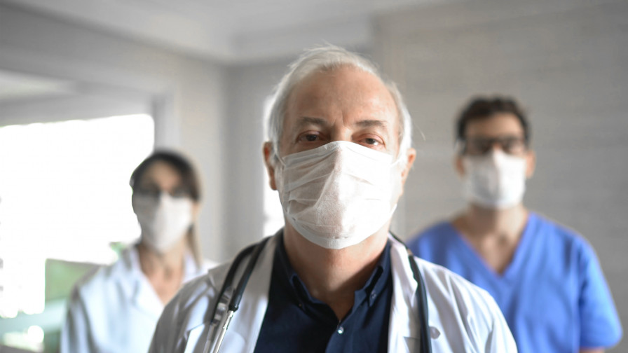 Three doctors with masks on